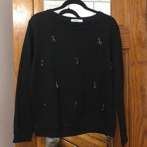 Sweaters - Daphnea tassel sweater in black